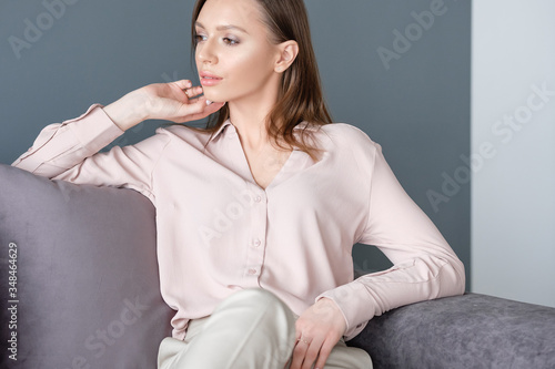 Pacified young relaxed woman is happy with her future plans and enjoy peace of mind and absence of stress on her cozy sofa at home Canvas Print
