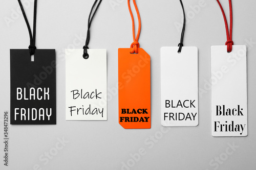 Fototapety, obrazy: Different tags with text BLACK FRIDAY on light background, flat lay