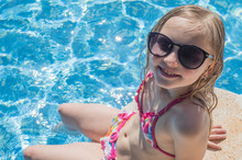Summertime Fun. Happy Girl In Pool In Sunny Day. Vacations.