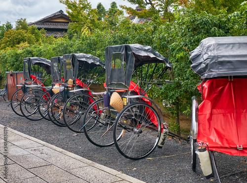 A pulled rickshaw carts (or ricksha) on the street of old Kyoto Tapéta, Fotótapéta