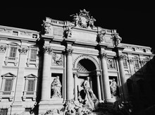 Low Angle View Of Trevi Fountain Against Sky On Sunny Day