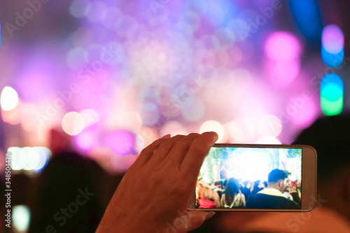 Close up of recording video with smartphone during a concert Canvas Print