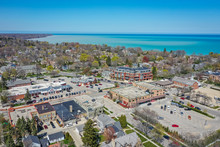 Milwaukee, WI / USA - May 12, 2020:  Aerial View Of Shopping District Of Suburban Whitefish Bay Wisconsin. Scene Looks North East Towards Lake Michigan