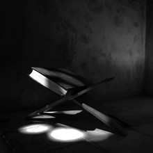 Koran On Book Stand With Sunlight In Room