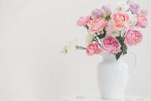 Beautiful Roses In Ceramic Whi...