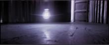 Close-up Of Lit Light Bulb Over Empty Flooring