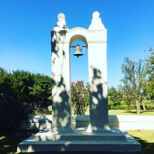 Slave Bell Hanging From Monument Against Clear Sky At Park