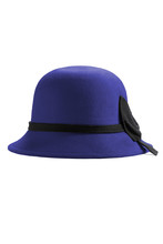 Subject Shot Of A Royal Blue Cloche Hat Decorated With A Wide Black Band And A Bow Knot. The Stylish Hat Is Isolated On The White Backdrop.