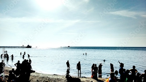 Fotografie, Obraz Group Of People On Sandy Beach