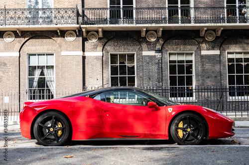 Red Ferrari parked on Georgian London street Poster Mural XXL