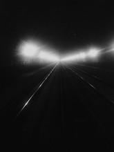 Railroad Tracks At Illuminated Tunnel