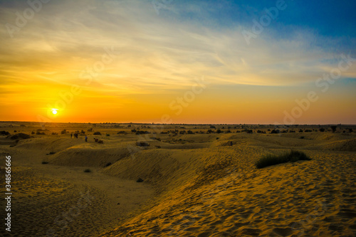 Photo Sunset view with camel at Sam sand dunes of Jaisalmer the golden city, an ideal