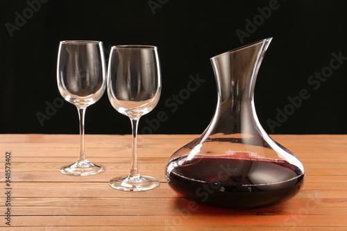 Decanter of wine and glasses on table Wallpaper Mural