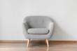 Leinwanddruck Bild Comfortable armchair near grey wall in room