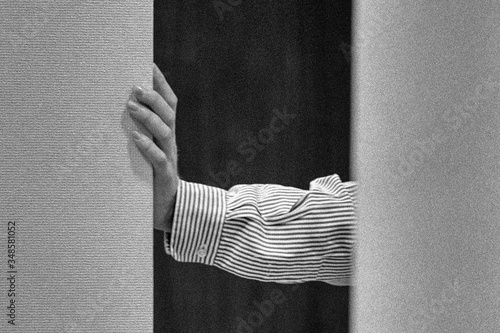 Cropped hand of businessman wearing striped shirt in doorway