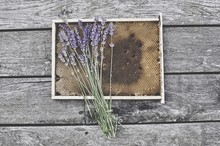 High Angle View Of Honeycomb And Lavender On Wooden Table