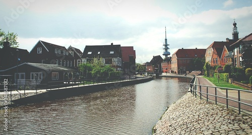 Fotografie, Tablou City At Waterfront Against Cloudy Sky