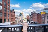 Fototapeta Nowy Jork - Young girl on a bridge in the High line park
