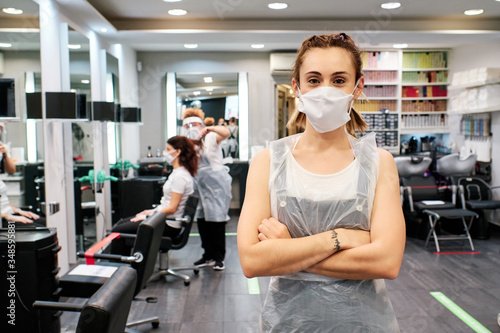 hairdresser ready to attend clients using face mask - social distancing concept Canvas Print