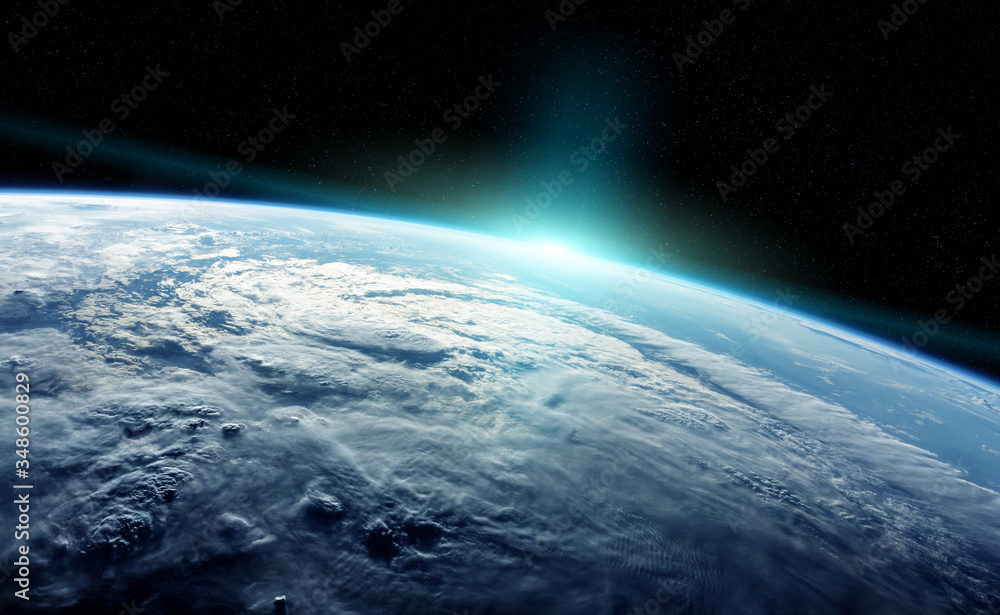 Fototapeta View of planet Earth close up with atmosphere during a sunrise 3D rendering elements of this image furnished by NASA