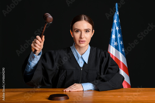 Stampa su Tela Female judge at table in courtroom
