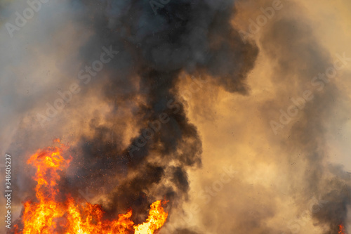 Tablou Canvas raging dust smoke pattern background of fire burn in grass fields, forests and b
