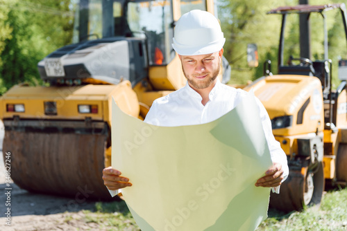 engineer near road machinery Canvas Print