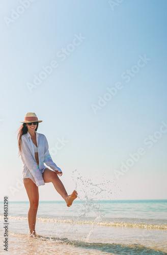 Fototapeta Woman on the beach during caribbean vacation obraz