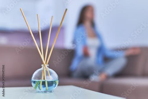 Obraz na plátně Aroma sticks and essential oil bottle for aromatherapy, meditation and mental he