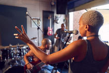 Female Musician Singing Into M...