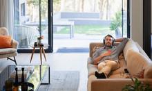 Man Relaxing On Living Room So...