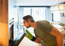 Man Cooking, Opening Oven Door...