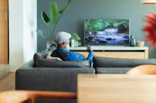 Man Watching TV On Living Room...