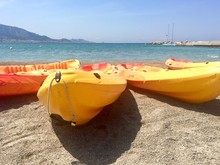 Yellow Canoes At Sandy Beach