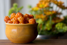 Cloudberry (Rubus Chamaemorus) Close Up In Orange Bowl On Wooden Table,autumn Harvest In Norwegian Mountains Near Hemsedal Ski Resort,Buskerud,Norway,photo For Printing On Calendar,poster,wallpaper