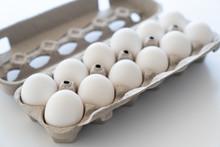 One Dozen White Eggs In A Carton Package