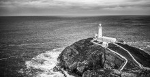 High Angle View Of South Stack Lighthouse Against Cloudy Sky