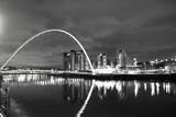 Gateshead Millennium Bridge Over Tyne River By Illuminated City At Night