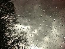 Cloudy Sky Seen Through Wet Glass Window