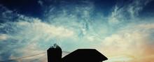 Silhouette Of Patio Umbrella A...