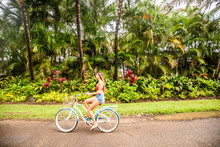 A Young Girl Riding Her Bicycl...