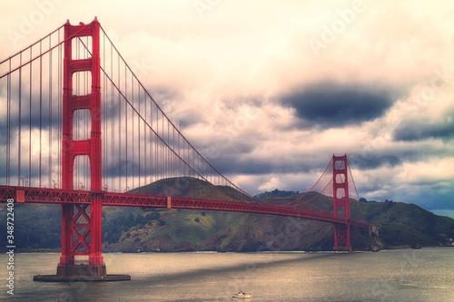 фотография Golden Gate Bridge Over River Against Sky