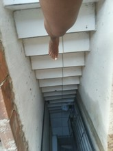 Person Stepping Down Staircase