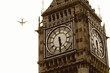 Low Angle View Of Airplane Flying By Big Ben Against Sky