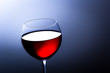 Glass of red italian wine on blue gradient