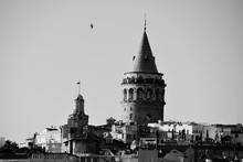 Galata Tower Amidst Houses Aga...