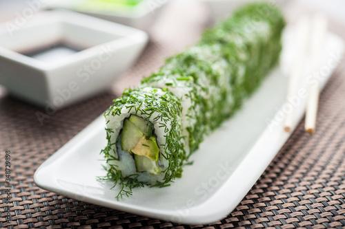 Fototapeta Uramaki sushi vegi green maki on a dish obraz
