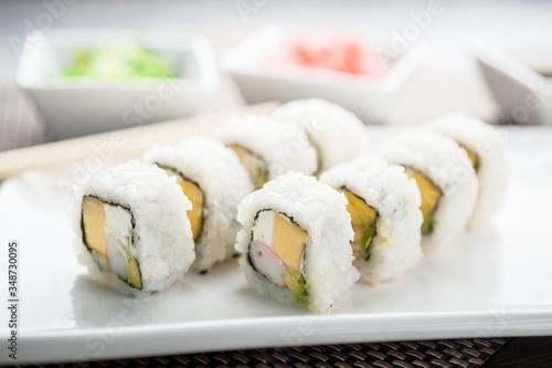 Fototapeta Uramaki sushi yasushi maki on a dish obraz
