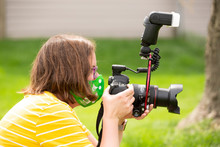 Woman Photographing, Wearing A...