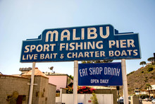 Malibu, California, Year 2016: Malibu Beach Pier Signpost. Sport Fishing Pier. Vacations.